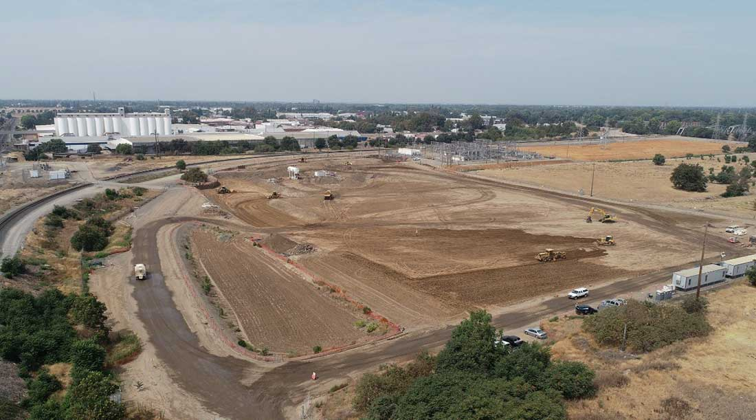 Wide view of substation E site during backfilling