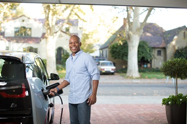 Image of customer plugging in his electric vehicle