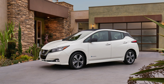 Nissan LEAF in the driveway of a home.