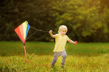 Image of a boy flying a kite