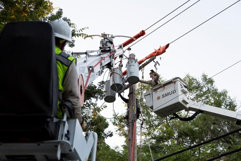 SMUD lineworkers working on a power pole