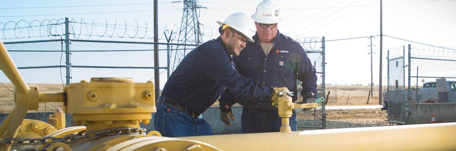 Two employees work on gas pipeline