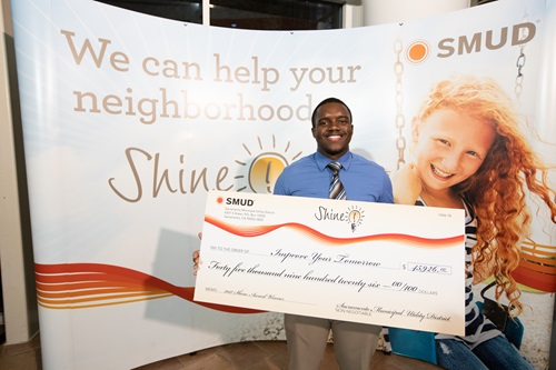 Image of shine awards winner holding a check for 45,926