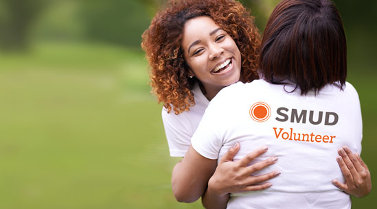SMUD volunteers hugging