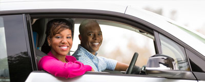 Happy couple in electric vehicle