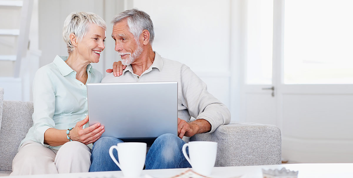 Retired couple with laptop computer