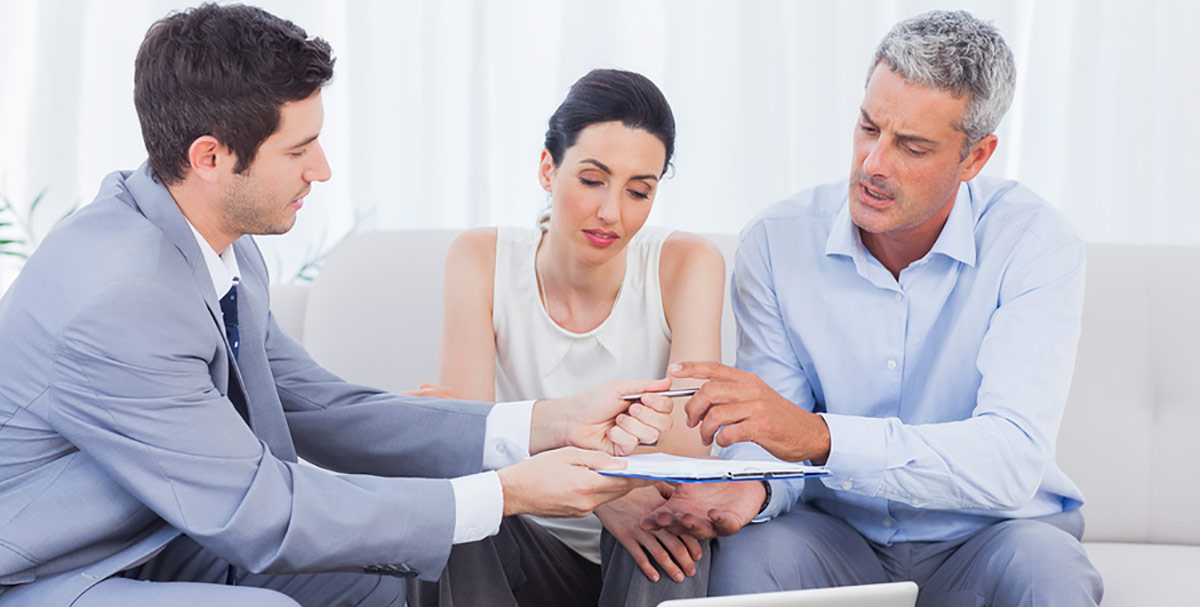 Couple negotiating with sales agent