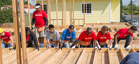SMUD employees building a community home