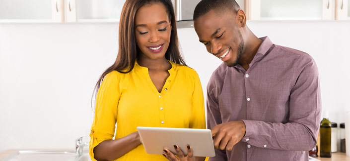 Young couple looking at tablet